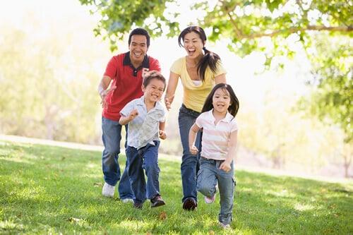 family running chasing kids