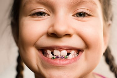 little girl smiling big with braces