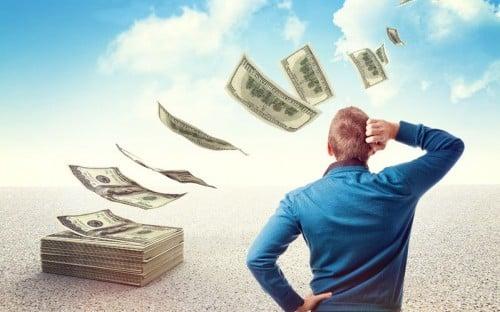 man watching money fly away